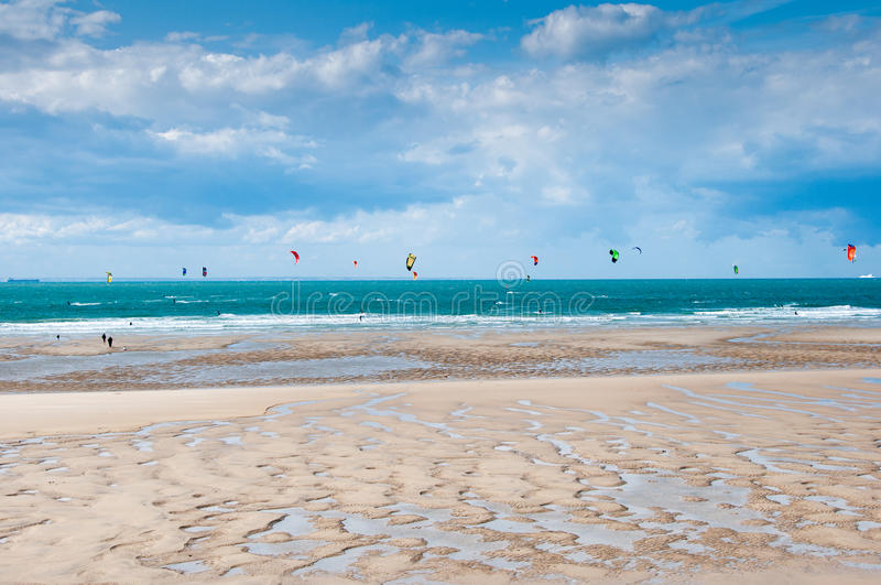 Kite and windsurfing. Kitesurfers and windsurfers in Wissant Beach, France royalty free stock image
