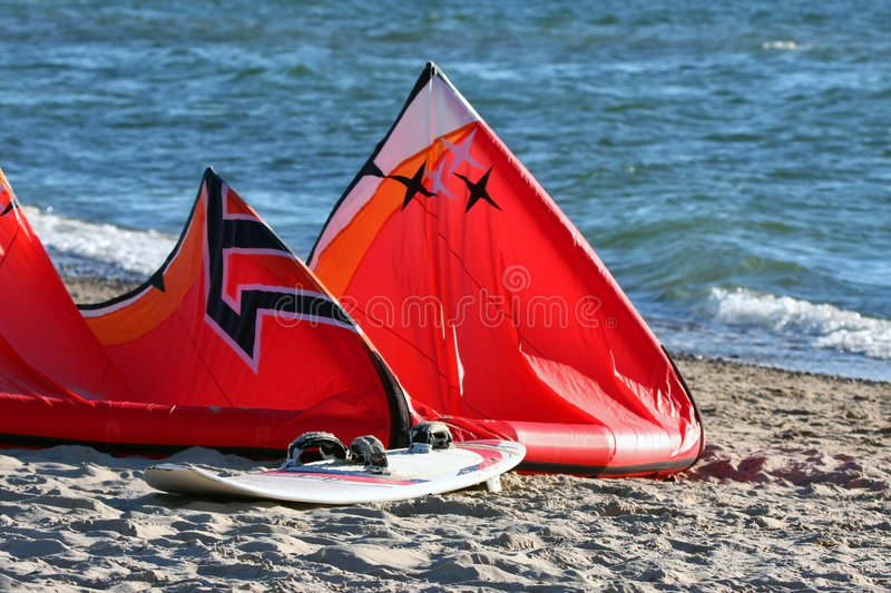 Kiteboard at the beach. Kiteboard set in the sandy beach royalty free stock images
