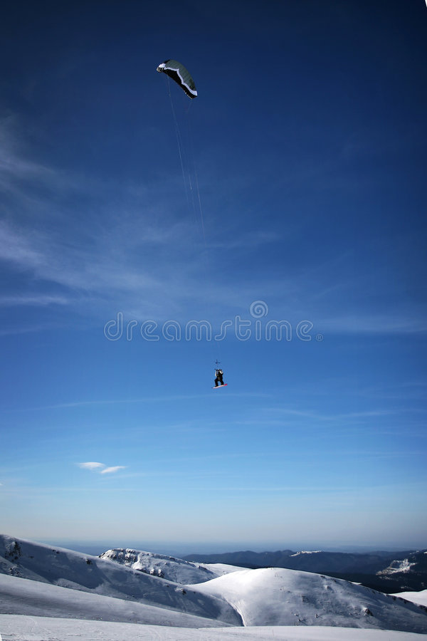 Kiteboarder. Performing a very high jump stock photography