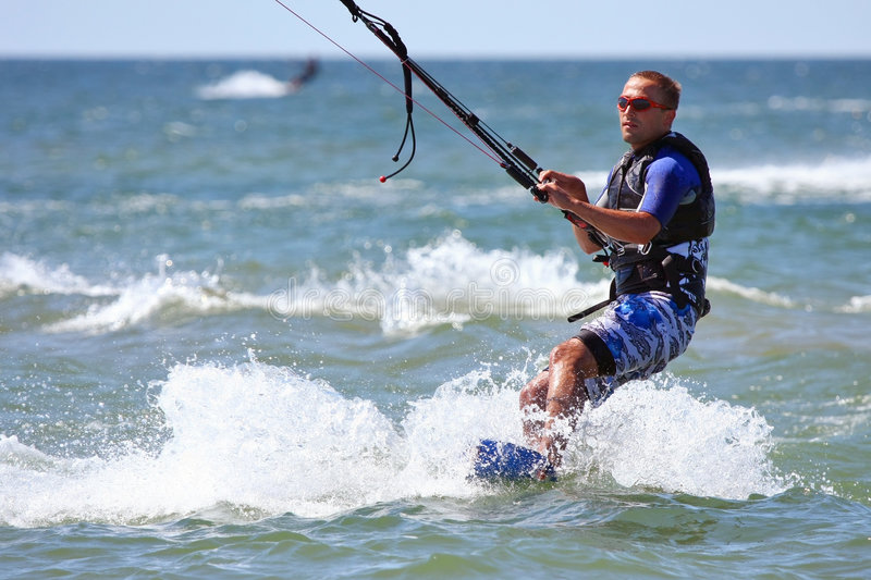 Kiteboarder. Surfing waves with kiteboard stock images