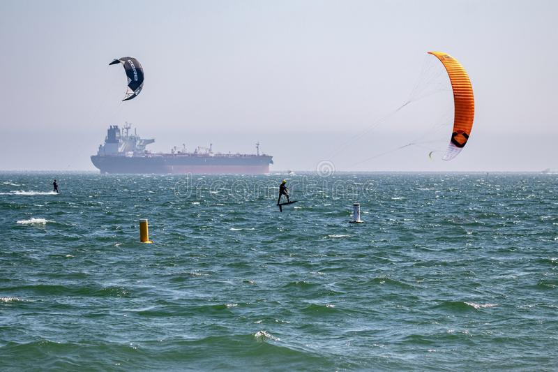Kiteboarders kite surfing in Long Beach, CA royalty free stock photos