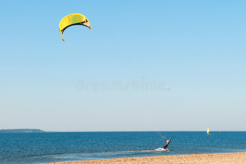 Kiteboarding. A kite surfer at the seaside royalty free stock photos