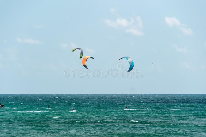 Kiteboarding activity. Waves and skyline stock photo