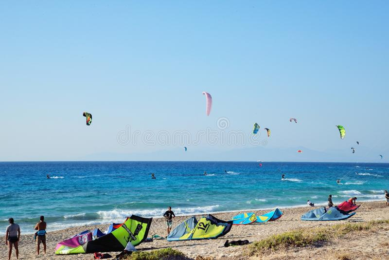 Kiteboarding. In Agios Nikita Beach, Lefkada Island,Greece, August 25, 2017, a beach full of people practicing royalty free stock photos