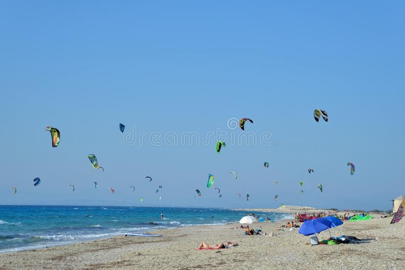 Kiteboarding. In Agios Nikita Beach, Lefkada Island,Greece, August 25, 2017, a beach full of people practicing royalty free stock image