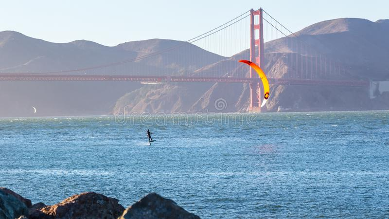 Kiteboarding in the Bay Area. San Francisco has a lively energetic spirit about the place. kiteboarding and other water-sports activities are popular around the stock photo