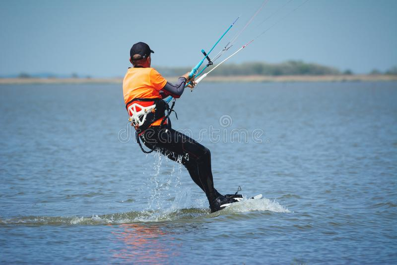 Kiteboarding on the blue sky action photos royalty free stock photography