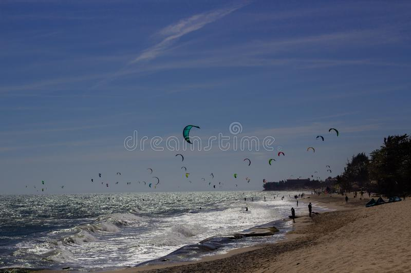 Kiteboarding, itesurfing at sunset in Mui Ne beach, Vietnam Phan Thiet royalty free stock photos