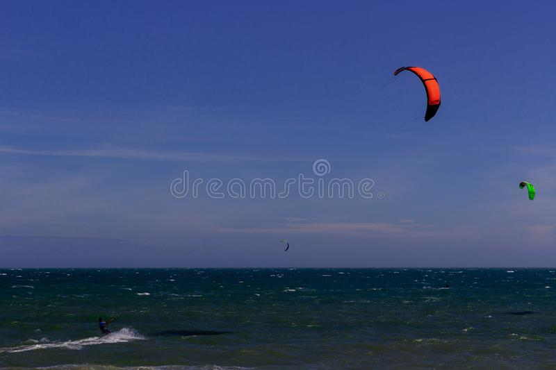 Kiteboarding, itesurfing at sunset in Mui Ne beach, Vietnam Phan Thiet.  royalty free stock images