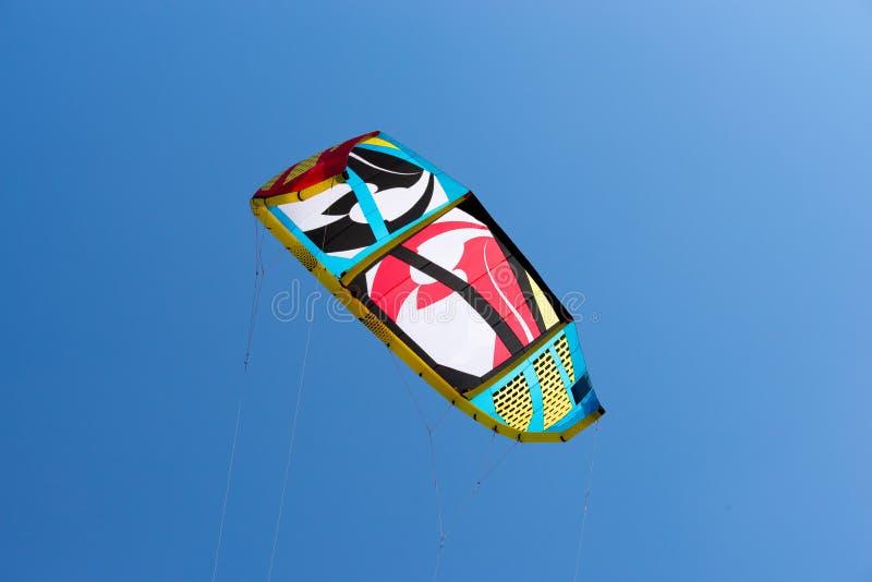 Kiteboarding kite. Kite flying in the sky. Kiteboarding kite. Colorful kite flying in blue sky stock image