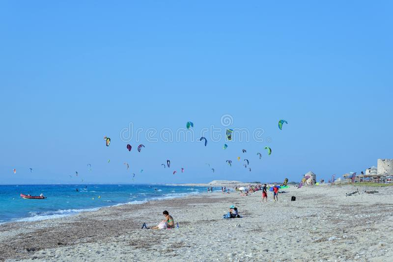 Kiteboarding. In Agios Nikita Beach, Lefkada Island,Greece, August 25, 2017, a beach full of people practicing royalty free stock photo