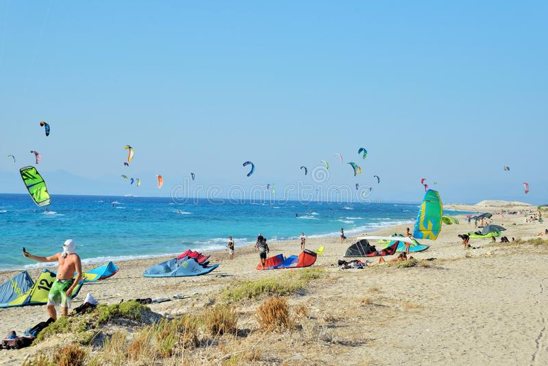 Kiteboarding. In Agios Nikita Beach, Lefkada Island,Greece, August 25, 2017, a beach full of people practicing stock photo