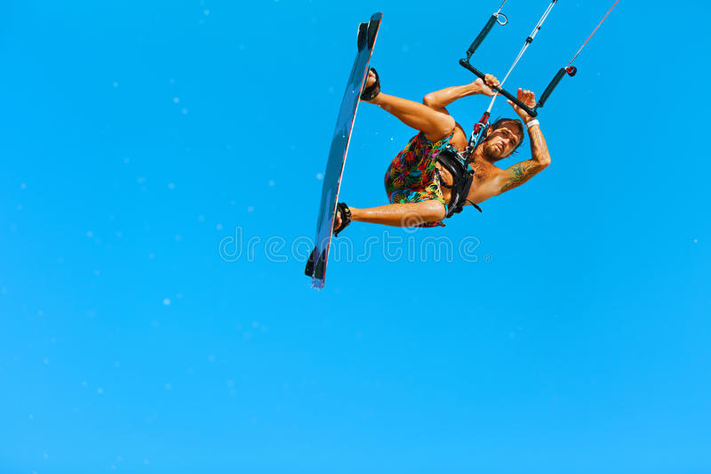 Kiteboarding, Kitesurfing. Extreme Water Sports. Surfer Air Action Summer Hobby. Kiteboarding, Kitesurfing. Water Sports. Professional Kite Surfer In Action In stock photography