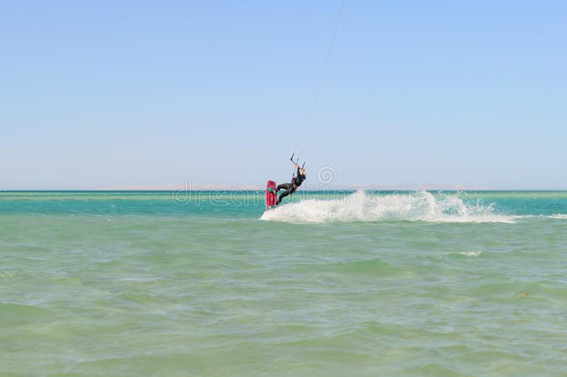Kiteboarding man on the sea. Photo royalty free stock photography