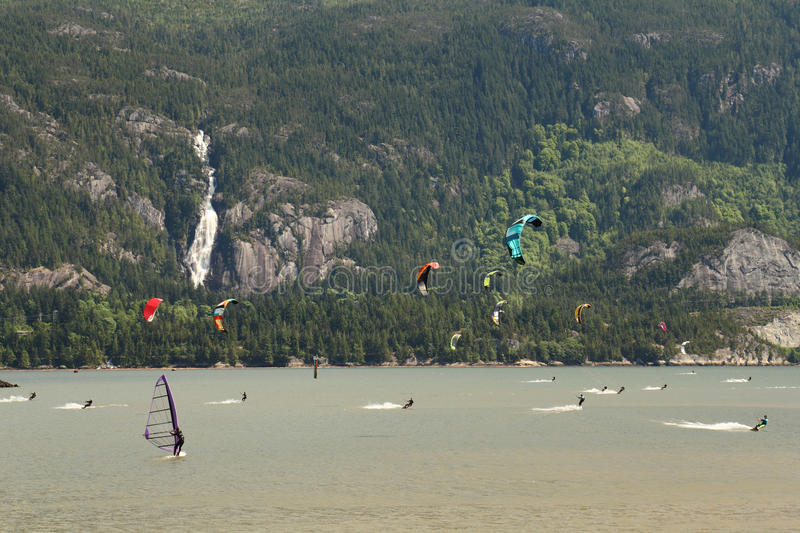 Kiteboarding, Squamish, British Columbia. Kiteboarders and windsurfers have almost guaranteed wind off Squamish Spit where the Squamish River empties into the stock photos