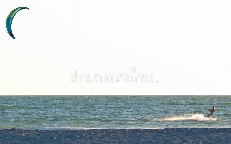 Kiteboarding Three. A photo of a man kiteboarding close to the shore in the Gulf of Mexico near Sarasota Florida stock image