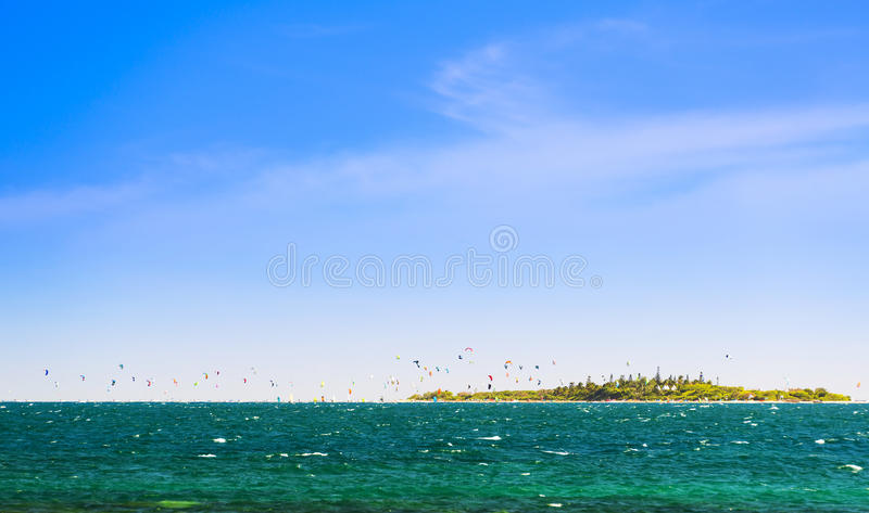 Kiteboarding Tropical Island. Kiteboarding around the tropical island Ilot Maitre in New Caledonia royalty free stock image