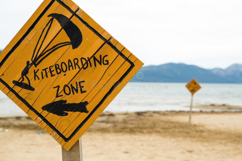 Kiteboarding, wooden kitesurfing sign on beach. Kiteboarding sign, wooden kitesurfing signpost on a beach at adriatic sea in Croatia. Inspiring kitesurfer stock photos