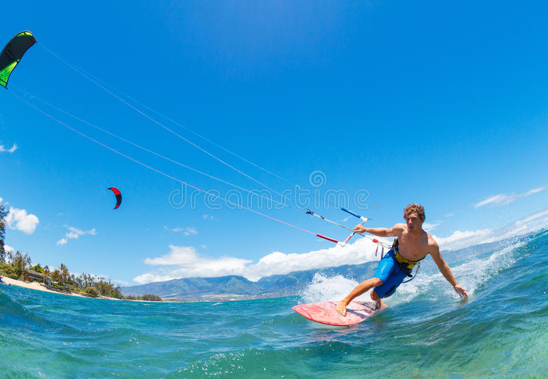 Kiteboarding. Young Man KiteBoarding, Fun in the ocean, Extreme Sport Kitesurfing stock photo