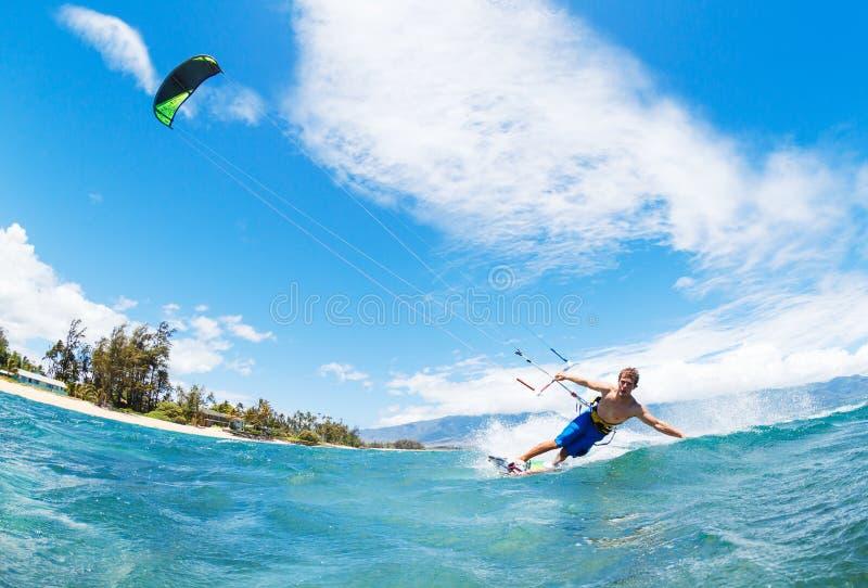 Kiteboarding. Young Man KiteBoarding, Fun in the ocean, Extreme Sport Kitesurfing stock image