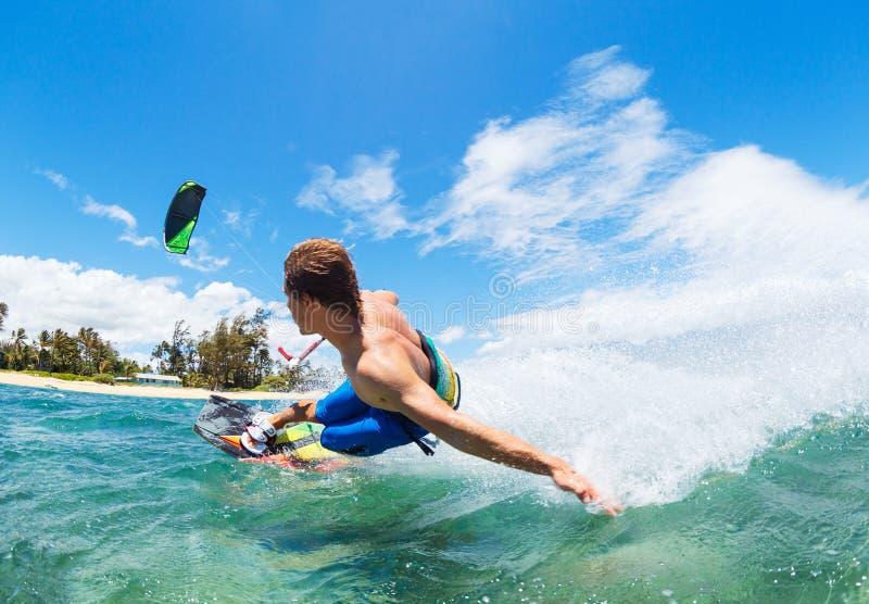 Kiteboarding. Young Man KiteBoarding, Fun in the ocean, Extreme Sport Kitesurfing royalty free stock photos