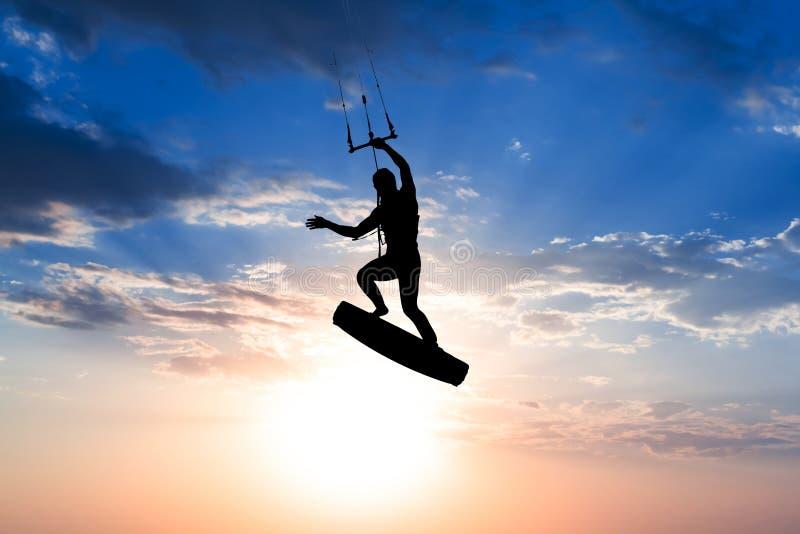 Kiter riding on a board royalty free stock photos