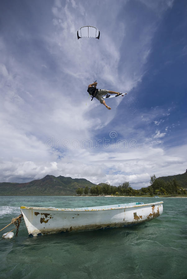 Free Kiter S Jump Over A Boat Royalty Free Stock Photos - 13725078