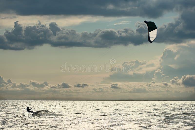 Kiter in sea stock photos