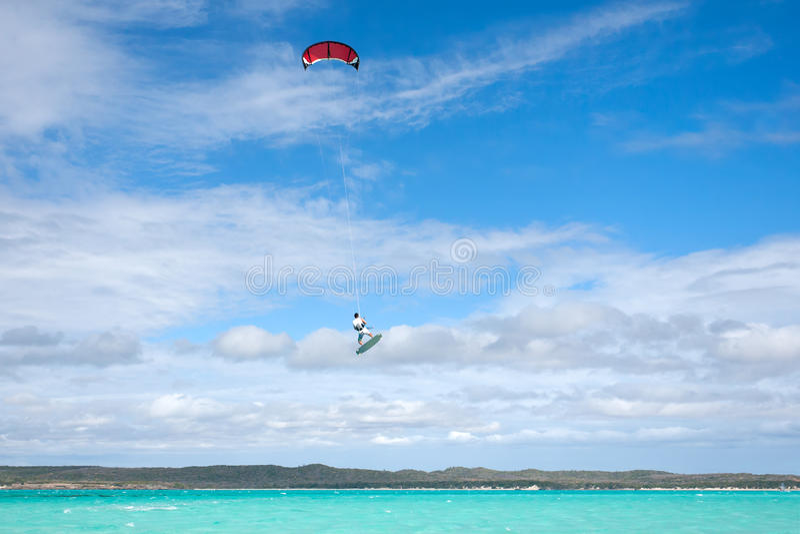 Kitesurf. Male kitesurfer jumping in the lagoon of Babaomby, Madagascar royalty free stock image