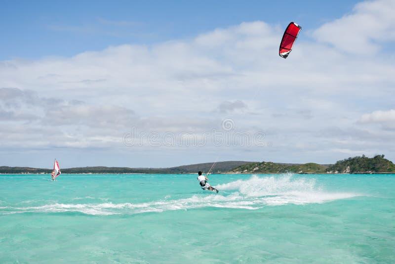 Kitesurf in the lagoon. Male kitesurfer kitesurfing in the lagoon of Babaomby, Madagascar stock photo