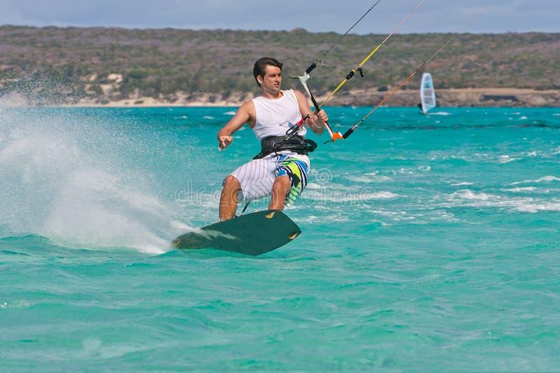 Kitesurf in the lagoon. Male kitesurfer enjoying his sport in the lagoon of Babaomby, Madagascar stock photo