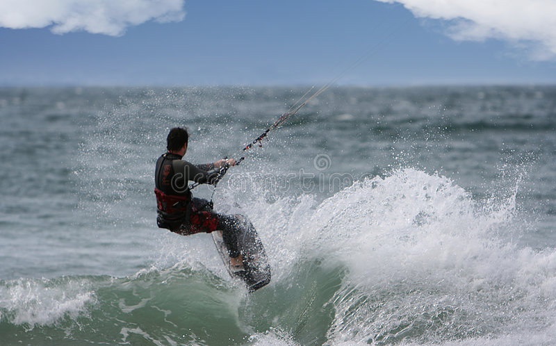 Kitesurfer. Flying over the wave royalty free stock photo