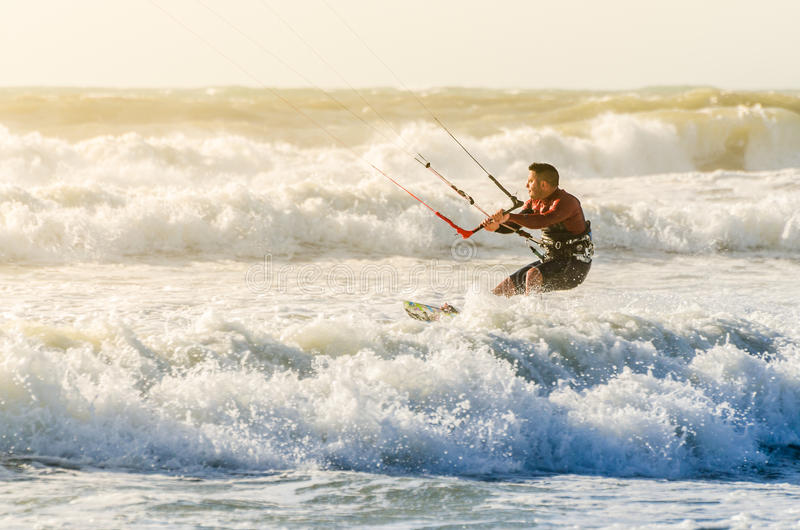 Kitesurfer. In action on a beautiful background of spray during the sunset stock photography