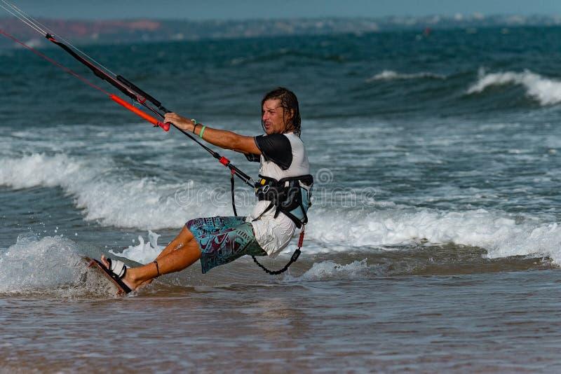 Kitesurfer In Action. Kitesurfing on the waves of the sea in Mui Ne beach, Phan Thiet, Binh Thuan, Vietnam. Kitesurfing, Kiteboarding action photos Kitesurfer In royalty free stock photos