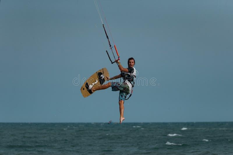 Kitesurfer In Action. Kitesurfing on the waves of the sea in Mui Ne beach, Phan Thiet, Binh Thuan, Vietnam. Kitesurfing, Kiteboarding action photos Kitesurfer In stock image