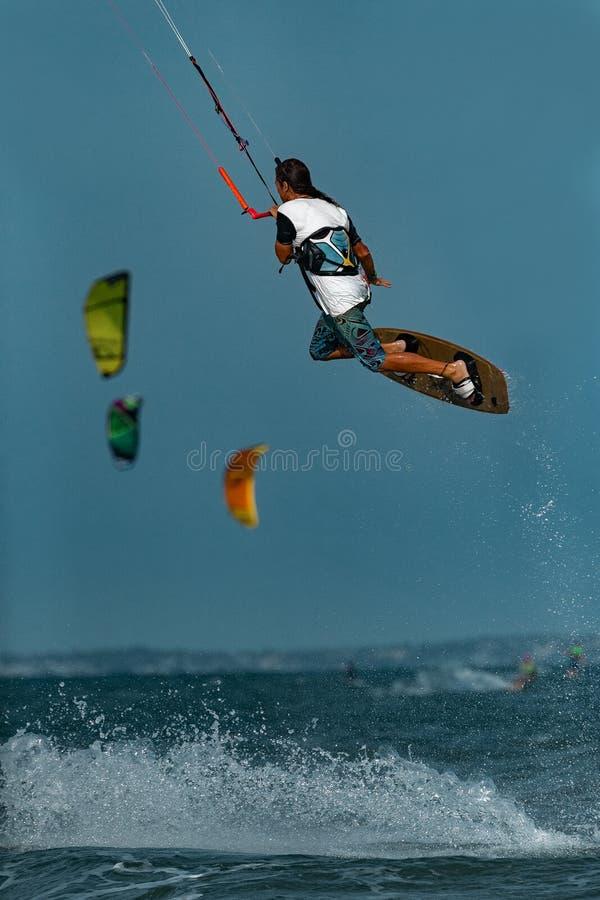 Kitesurfer In Action. Kitesurfing on the waves of the sea in Mui Ne beach, Phan Thiet, Binh Thuan, Vietnam. Kitesurfing, Kiteboarding action photos Kitesurfer In stock photography