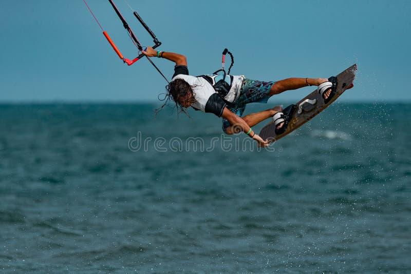 Kitesurfer In Action. Kitesurfing on the waves of the sea in Mui Ne beach, Phan Thiet, Binh Thuan, Vietnam. Kitesurfing, Kiteboarding action photosKitesurfer In royalty free stock photos