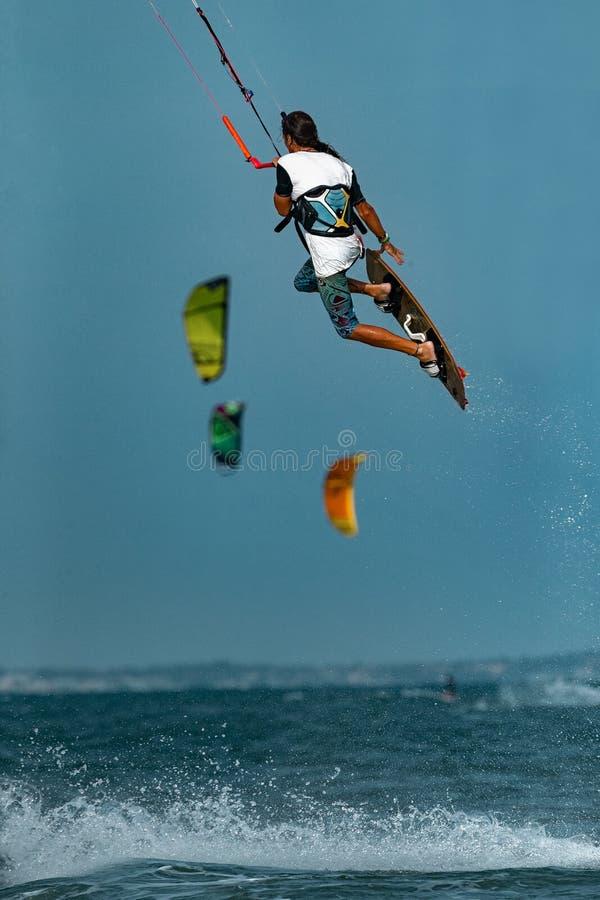 Kitesurfer In Action. Kitesurfing on the waves of the sea in Mui Ne beach, Phan Thiet, Binh Thuan, Vietnam. Kitesurfing, Kiteboarding action photosKitesurfer In stock photos