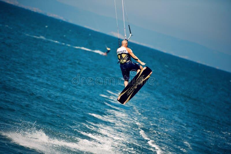 Kitesurfer in a jump stock photo
