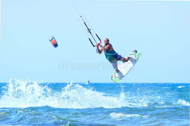 Kitesurfer during a jump. August 6, 2016 - San Nicandro Garganico (FG) Italy: Kitesurfer jumping on a wave in the Adriatic Sea royalty free stock images
