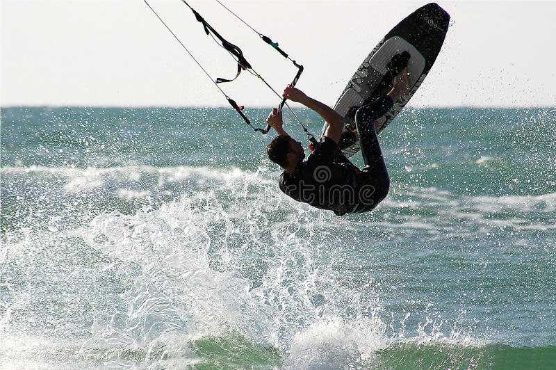 Kitesurfer jumps over the water. stock photo