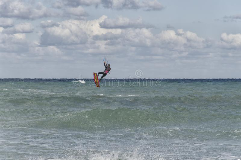 Kitesurfer land in the sea after a jump stock photos