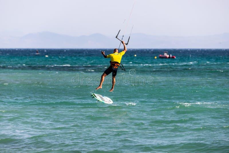A kitesurfer after landing a jump. stock photo