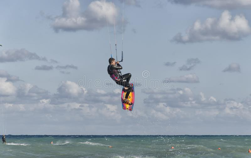 Kitesurfer while making an acrobatic leap stock image