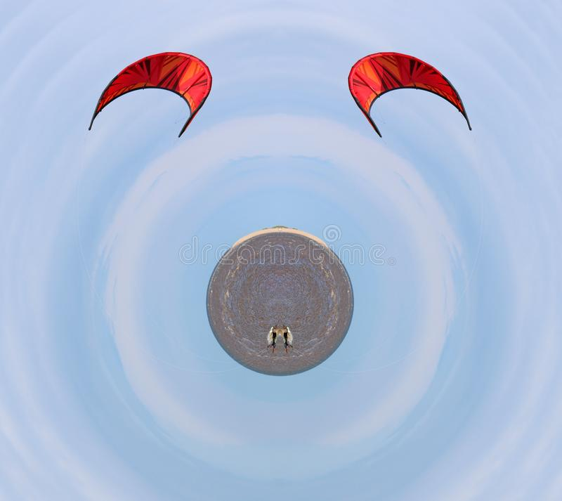 Kitesurfer på en miniatyrplanet royaltyfri foto