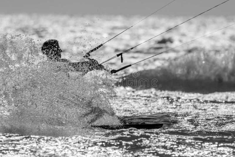 A kitesurfer splashing water royalty free stock photography