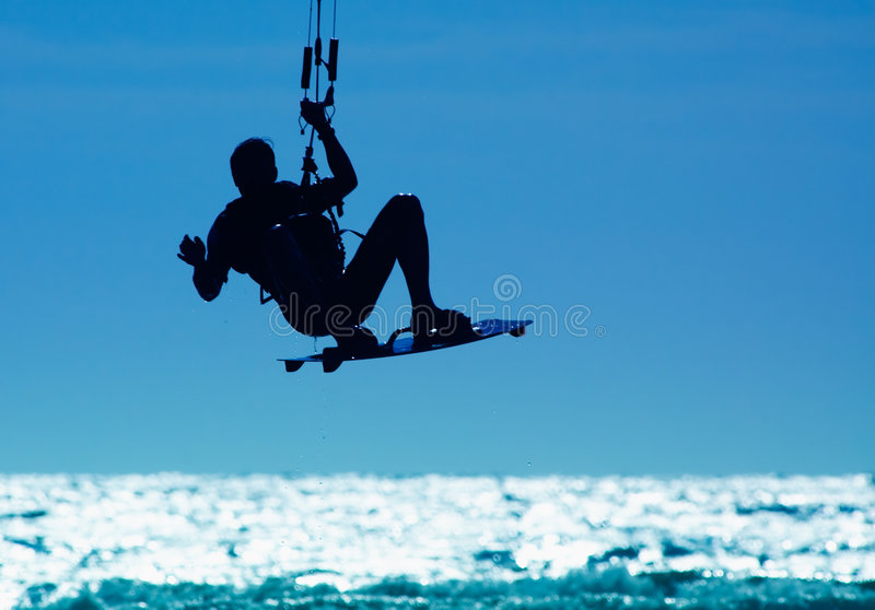 Kitesurfing. Kite boarder in action royalty free stock image