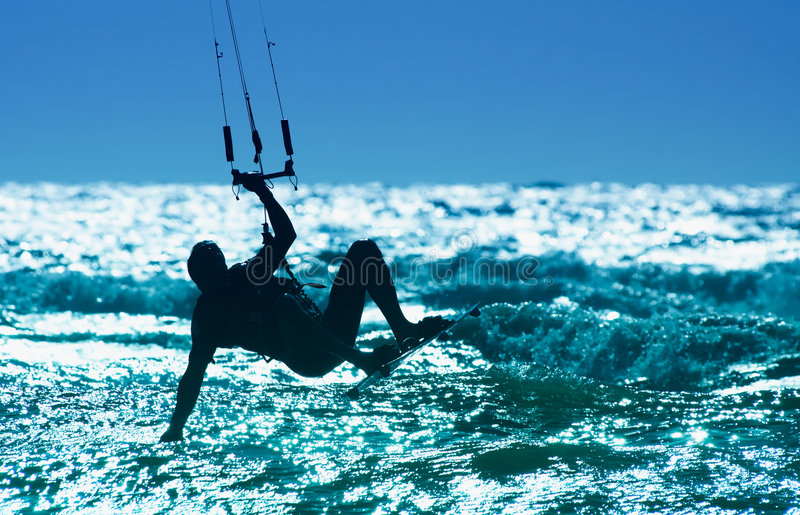 Kitesurfing. Kite boarder in action royalty free stock photos