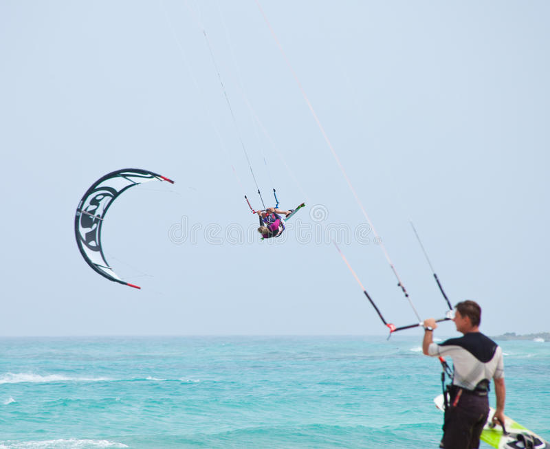 Kitesurfing. Fuerteventura,Spain - July 2012: Practicing kitesurfing (kiteboarding) at the Corralejo Flag Beach on Fuerteventura, Canary Islands. Strong winds stock images