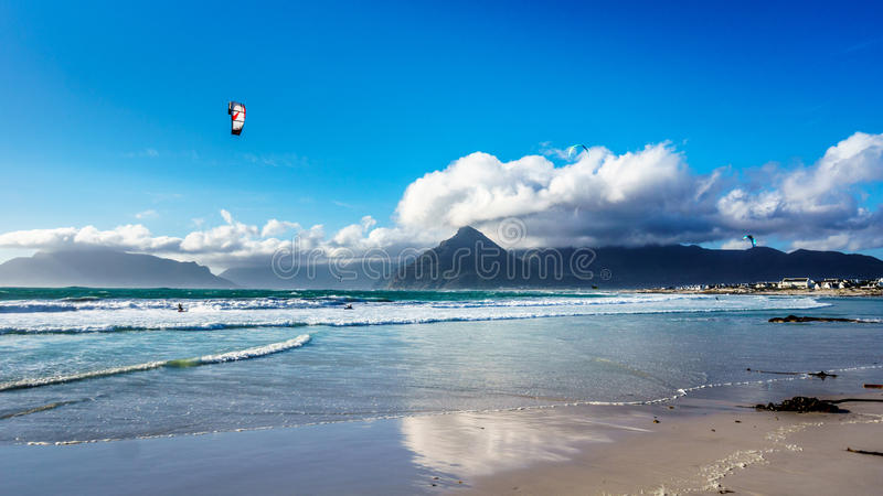 Kitesurfing at the beach community of Het Kommitjie near Cape Town. Kitesurfing at the beach community of Het Kommitjie on the Atlantic Ocean side of the Cape royalty free stock photography